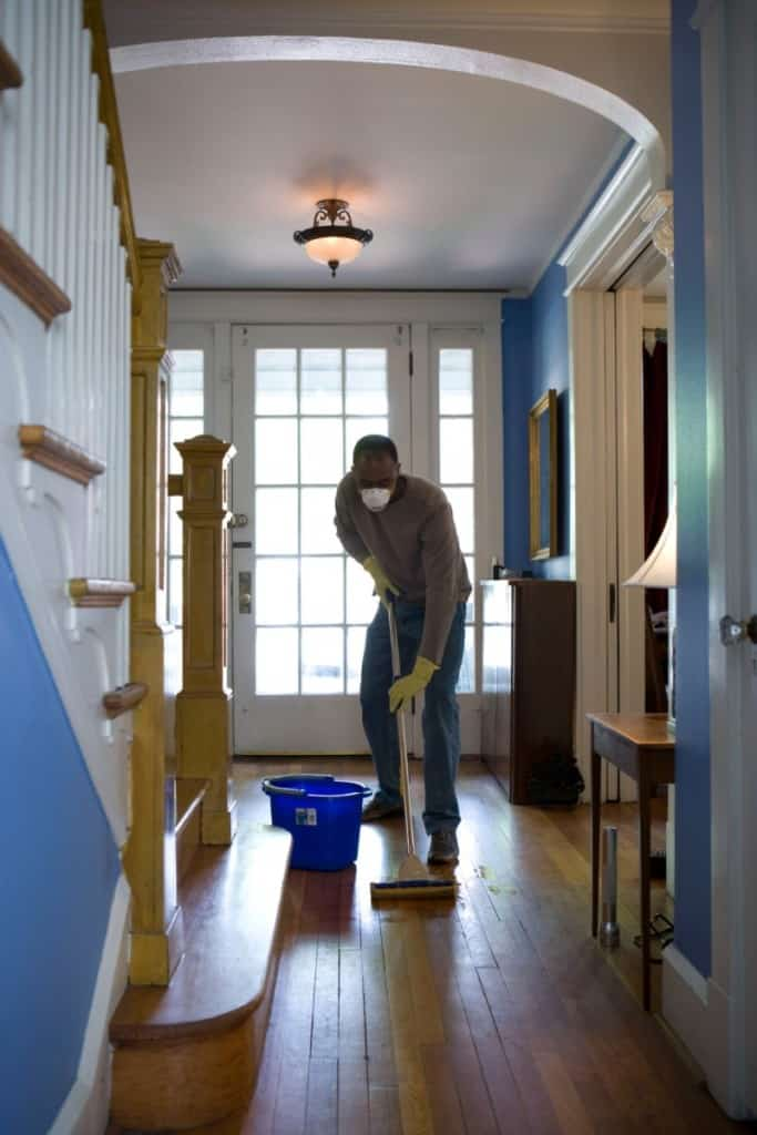 Man deep cleaning his home to prepare for sale