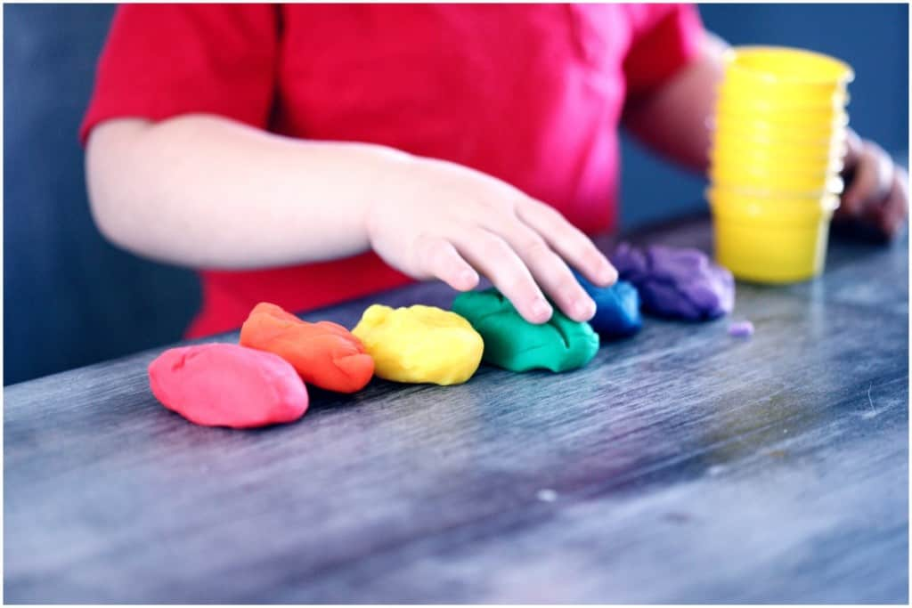 child playing with play-doh