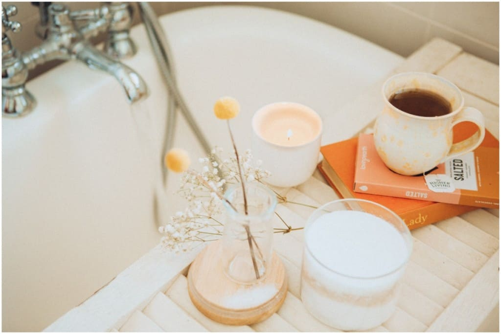 relaxing bath with books and candles