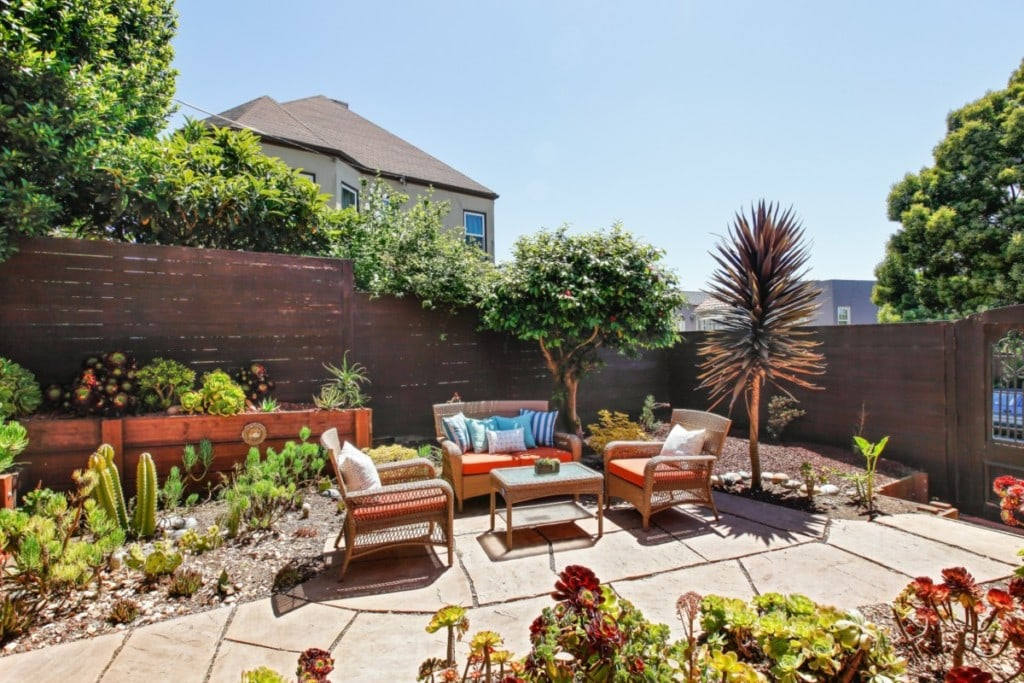 A backyard oasis idea realized with outdoor patio furniture and garden