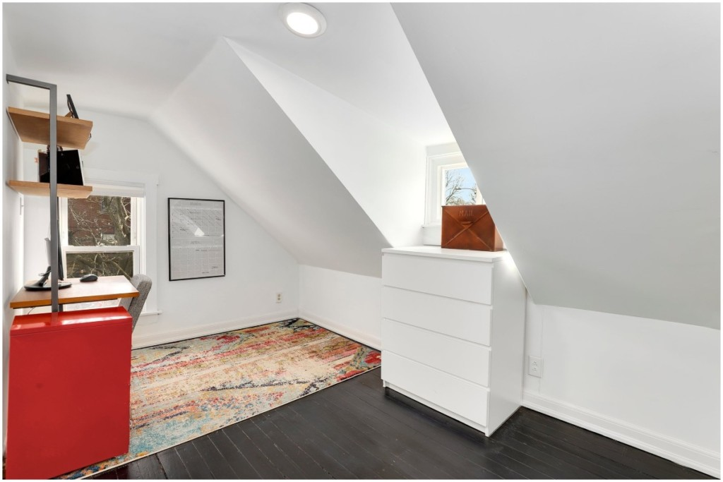 white attic home office colorful red rug natural light