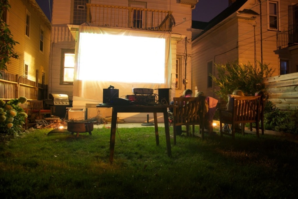 An outdoor movie theater completes this backyard oasis idea