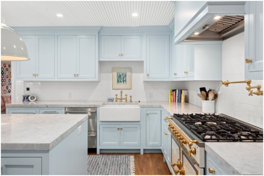 bright kitchen with blue cabinets