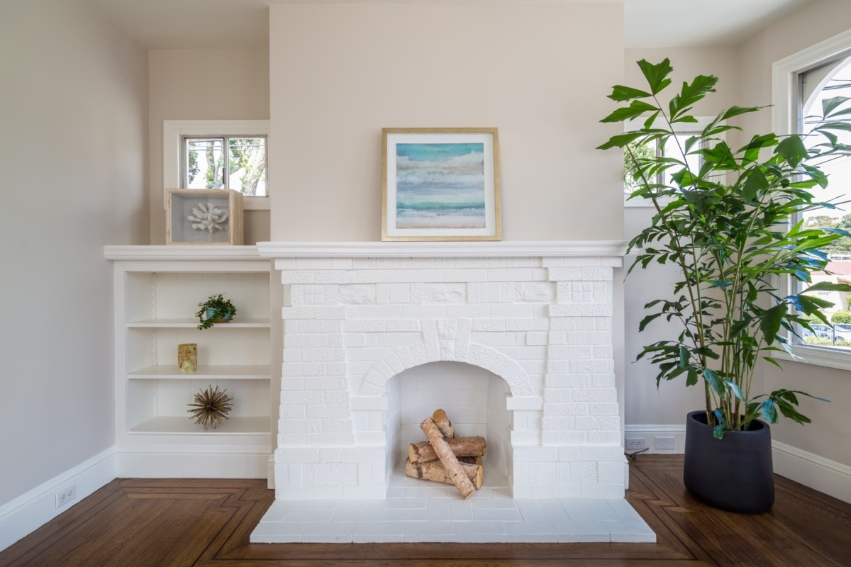 White painted brick fireplace perfectly staged for selling a home