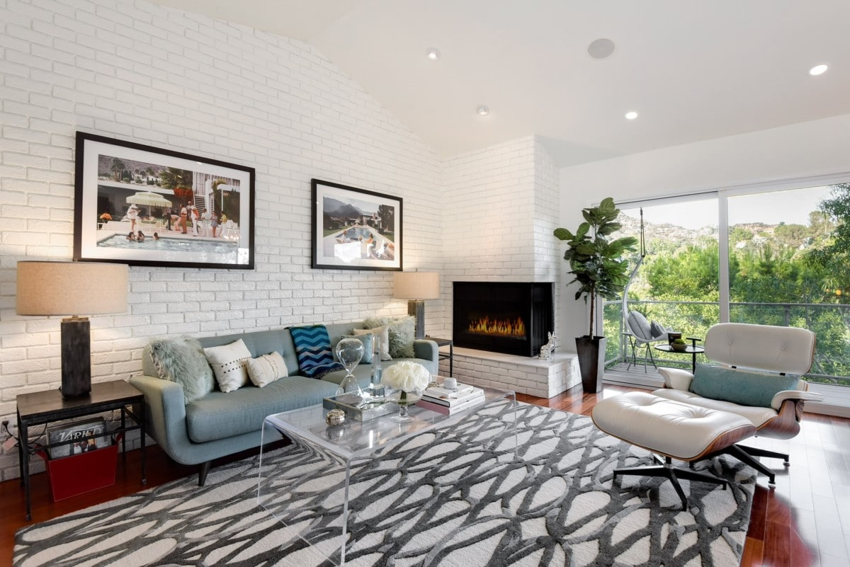Couch and accent chair in living with fireplace going