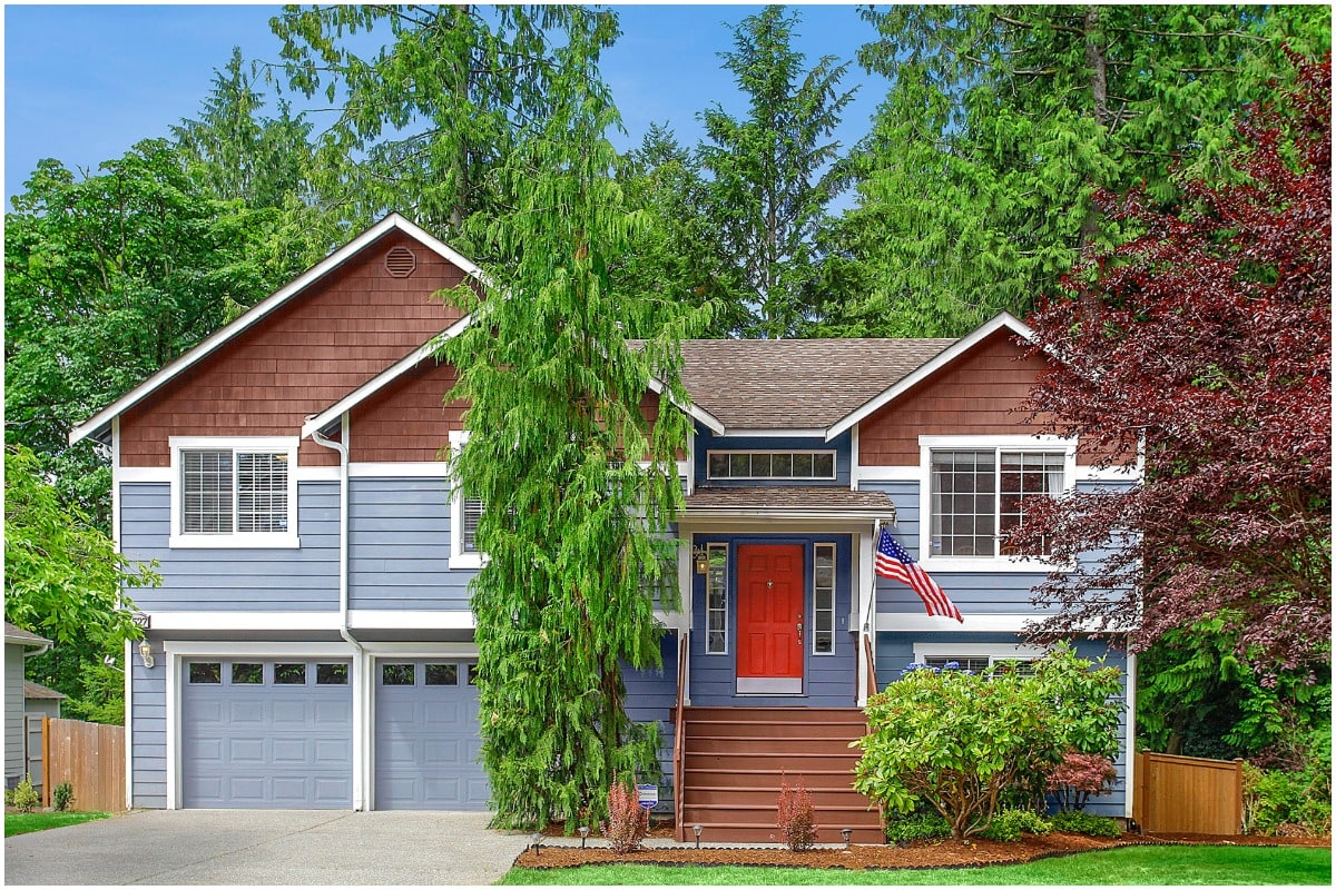 blue house with american flag and red front door
